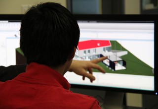 A student modeling a building